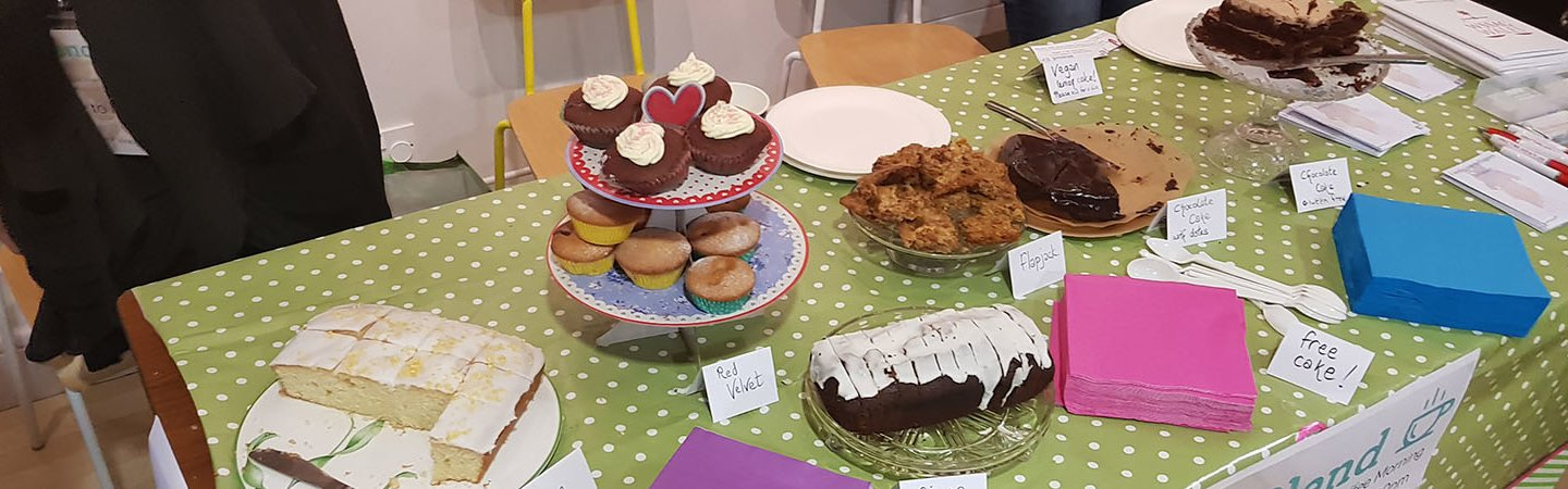 A table full of cakes and other sweet treats at a Refugee Week event.