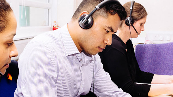 Migrant Help advisers on their headsets ready to take calls
